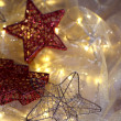 Stock Photo: Christmas ornaments and garland on bright background close-up