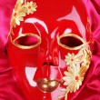 Stock Photo: Mask on bright pink fabric background