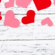 Beautiful decorative hearts on old wooden background — Stock Photo #37624645