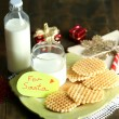 Cookies and milk for Santa. in wooden background — Stock Photo