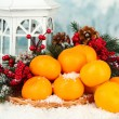 Christmas composition with ripe tangerines on bright background — Stock Photo #37625061