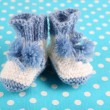 Crocheted booties for baby, on color background — Stock Photo #37625445