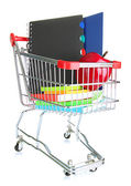 Trolley with school equipment and apple isolated on white — Stock Photo