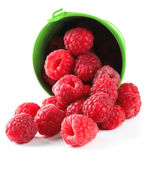 Ripe sweet raspberries in pail, isolated on white — Stock Photo