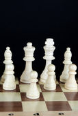 Chess board with chess pieces isolated on black — Стоковое фото