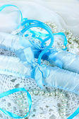 Beautiful hanger on fabric background — Stock Photo