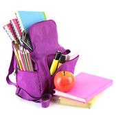 Purple backpack with school supplies isolated on white — Stock Photo