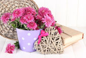 Bouquet of pink chrysanthemum in bucket on white wooden background — Zdjęcie stockowe