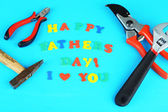 Happy Fathers Day (concept image with multicolor letters and tools, on wooden background) — Stock Photo