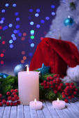 Candles and Christmas decoration on bright background — 图库照片