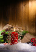 Candles and Christmas decoration on wooden background — 图库照片