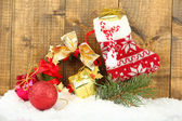 Beautiful Christmas wreath, on wooden background — Foto Stock