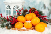 Christmas composition with ripe tangerines on bright background — Stock Photo