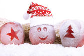 Holiday apples with frosted drawings in snow close up — Stock Photo
