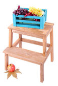 Wooden box with fruits, on small wooden ladder, isolated on white — Stock Photo