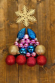 Christmas tree of Christmas toys on wooden table close-up — Stock Photo