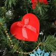 Heart - gift box on Christmas tree background, close-up — Stock Photo #37648877