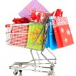 Christmas gifts and shopping in trolley isolated on white — Stock Photo #37655553