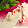 Stock Photo: Christmas candy canes and letters for Santa, on color wooden background