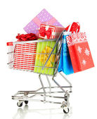Christmas gifts and shopping in trolley isolated on white — Foto Stock