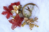 Clock and Christmas decorations under snow close up — 图库照片