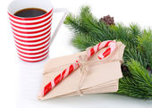 Christmas candy canes, cup with hot drink and letters for Santa, isolated on white — Zdjęcie stockowe