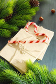 Christmas candy canes and letters for Santa, on color wooden background — 图库照片