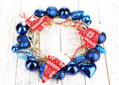 Christmas wreath of colorful balls on wooden table close-up — Stock Photo