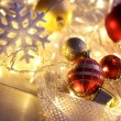 Christmas ornaments and garland on bright background close-up — Stock Photo