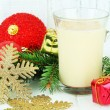 Cup of eggnog with fir branches and Christmas decorations on table on wooden background — Stock Photo