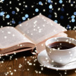 Stock Photo: Composition of book with cup of coffee on table on dark background