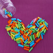 Dreams written on color rolled paper in glass jar, on color background — 图库照片