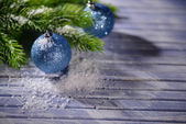 Christmas decorations on wooden table, on bright background — 图库照片