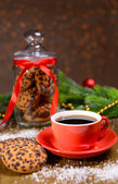 Delicious Christmas cookies in jar on table on brown background — Foto Stock