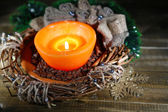 Burning candle with Christmas decorations on color wooden background — 图库照片