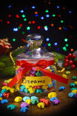 Paper stars with dreams on table on dark background — Foto Stock
