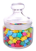 Paper stars with dreams in jar isolated on white — Zdjęcie stockowe