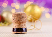Champagne cork on Christmas lights background — Stock Photo