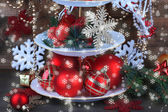 Christmas decorations on dessert stand, on wooden background — Photo