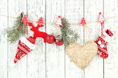 Christmas accessories hanging on white wooden wall — Stockfoto