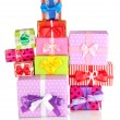 Foto de Stock  : Hill colorful gifts isolated on white