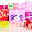 Stock Photo: Hill colorful gifts isolated on white