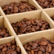 Coffee beans in wooden box close-up — Stock Photo #37722617