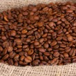 Coffee beans in bag close-up — Stock Photo #37722625