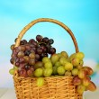 Fresh grape on wicker mat on bright background — Stock Photo