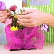 Florist makes flowers bouquet — Stock Photo #37723541