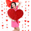 Attractive young woman with heart on Valentine Day — Stok fotoğraf