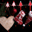 Christmas accessories on black background with lights — Stock Photo #37724661