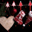 Christmas accessories on black background with lights — Stock Photo