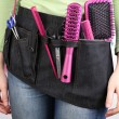 Womhairdresser with tool belt on bright background — Stock Photo #37724695